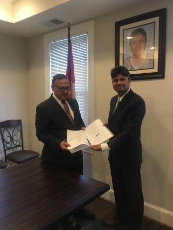 Dr Sigdel with HE Ambassador Dr Arjun Karki